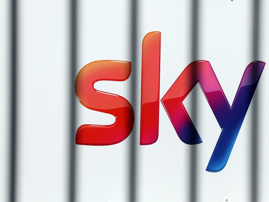 The Sky logo sits on a sign outside Sky Plc headquarters in London on Friday.