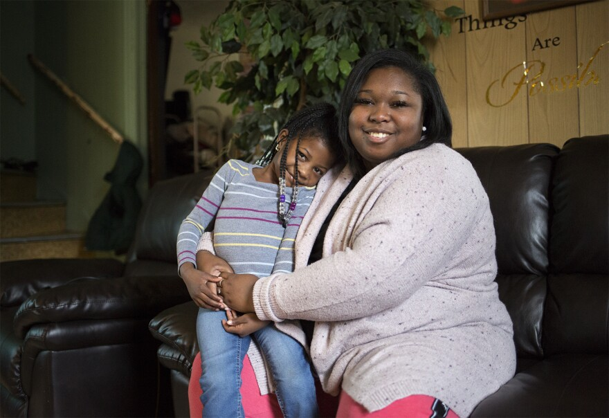 Satin White poses for a portrait with her 5-year-old daughter, Amor Robinson on Feb. 15, 2020. The girl already knows about gunfire. 'I don't like the pop, pop noises,' she says.