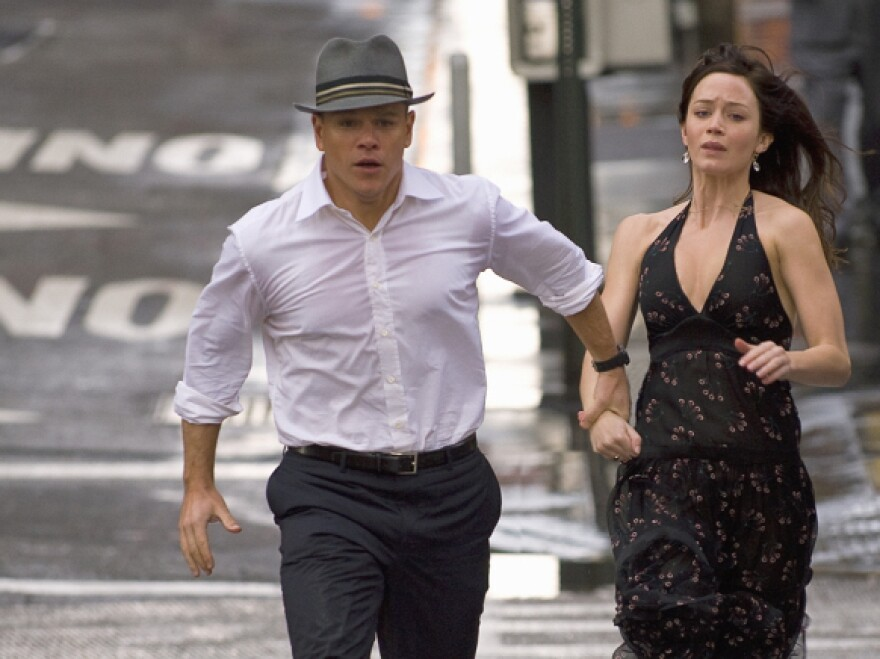 <strong>On The Run:</strong> Aided by a portal-opening fedora, David Norris (Matt Damon) and Elise Sallas (Emily Blunt) attempt to escape the heavy hand of fate in <em>The Adjustment Bureau.</em>