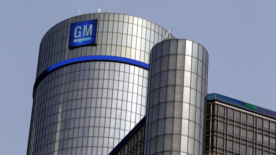 The General Motors logo is displayed atop the Renaissance Center in Detroit. The automaker, while doing much better following the government bailout, is still lagging some of its competitors.