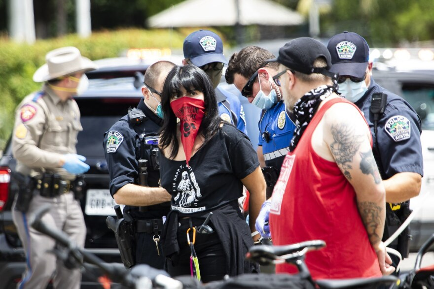Police arrest activists following a demonstration along I-35 demanding rent relief during the coronavirus pandemic.