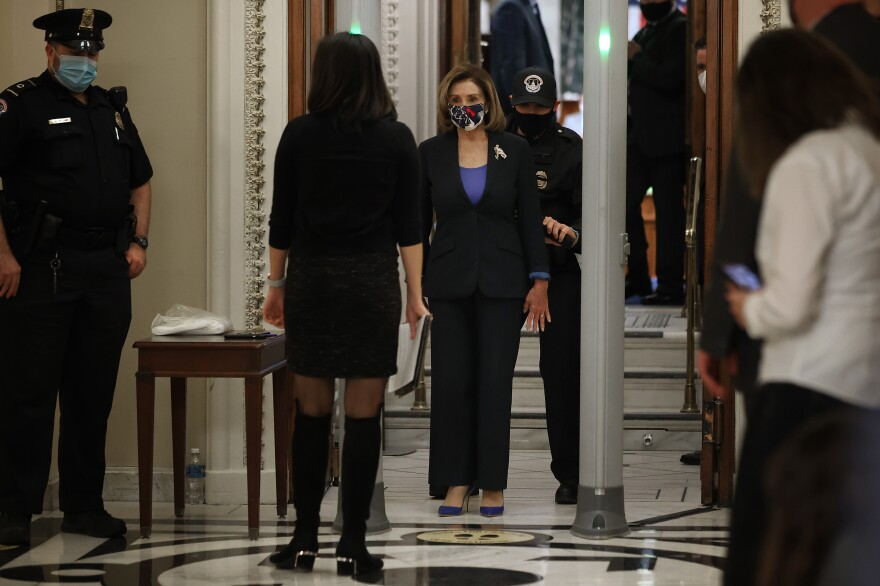 Speaker of the House Nancy Pelosi, D-Calif., is screened at a metal detector at the doors of the House of Representatives Chamber on Tuesday.