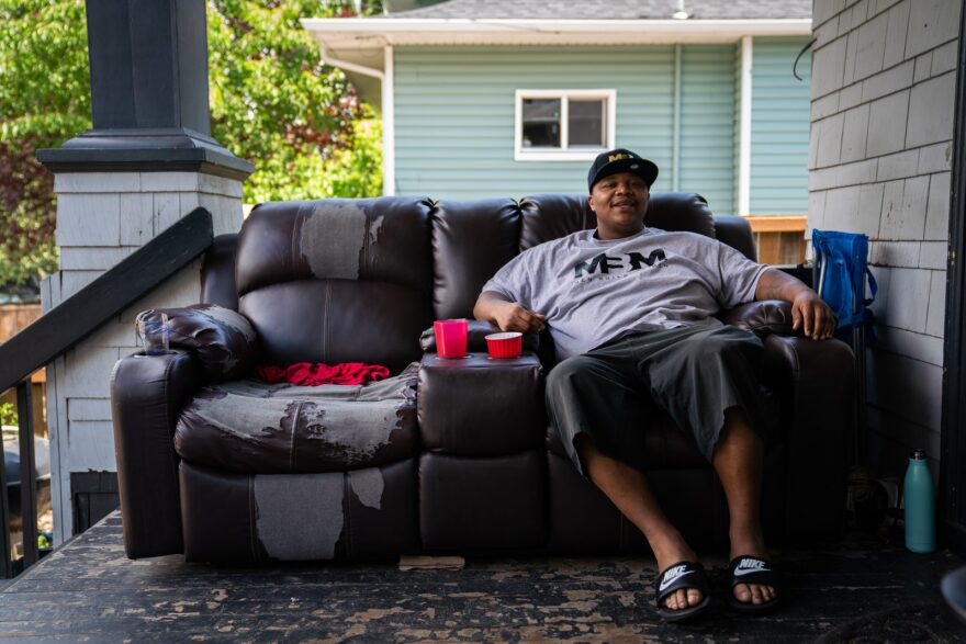Lionel Irving sits on his porch on July 1, 2019, in North Portland, Oregon. Lionel is trying to interrupt the cycle of violence in his community that led him to join a gang at a young age.