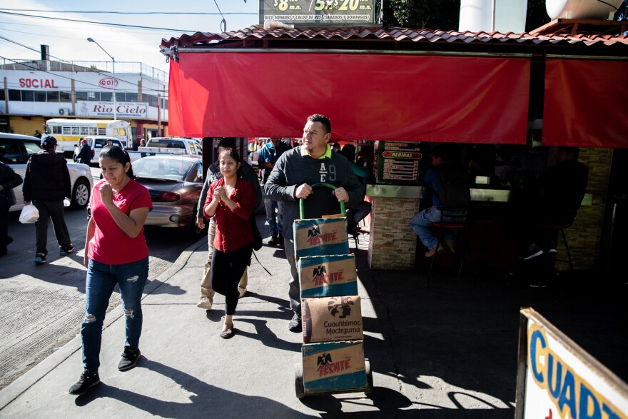 José Aguilar heads to the store on a supply run in Tijuana, Mexico. His restaurant Honduras 504 has become a community center for Honduran legal residents and unauthorized migrants alike.
