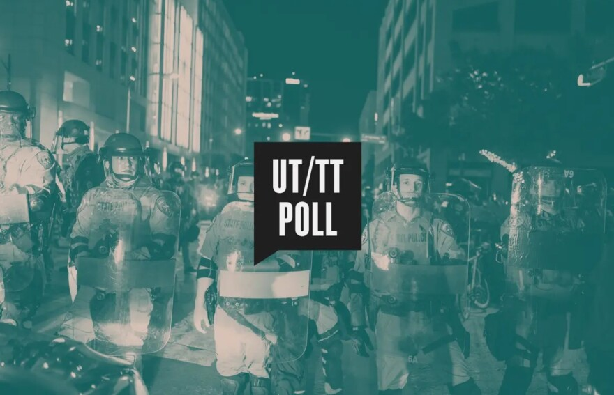 State police in riot gear are seen behind the Texas Tribune/UT Poll logo