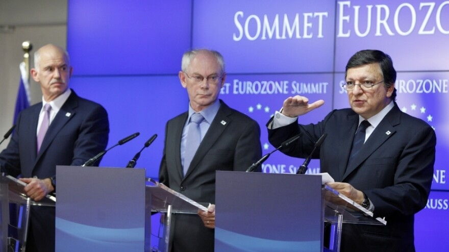 From left, Greek Prime Minister George Papandreou, European Council President Herman Van Rompuy and European Commission President Jose Manuel Barroso participate in a news conference after eurozone leaders agreed on a second bailout package for Greece.