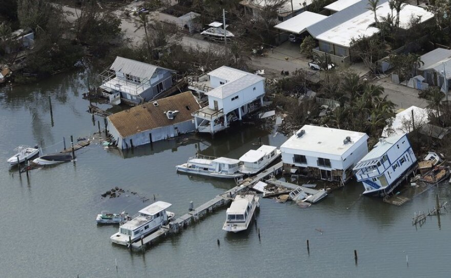 Homes and boats damaged by Hurricane Irma in Key West are pictured in September.