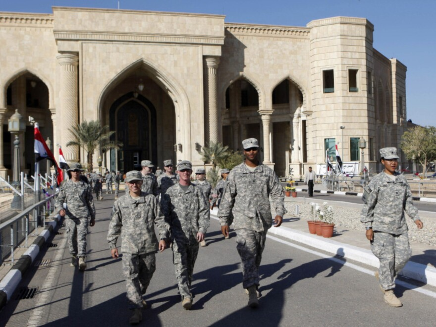 "U.S. troops leave Al Faw palace at Camp Victory in Baghdad earlier this month. The complex was a significant point of logistics for the Iraq War and was recently transferred to <a href=""http://www.npr.org/2011/12/02/143038873/icon-of-u-s-military-now-in-iraqi-hands"">Iraqi control</a>."