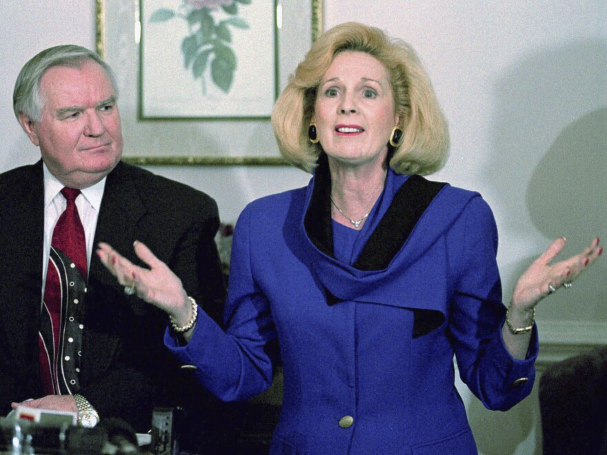 In this March 2, 1995 file photo, Word of Faith Fellowship church leader Jane Whaley talks to members of the media, accompanied by her husband, Sam, in Spindale, N.C.