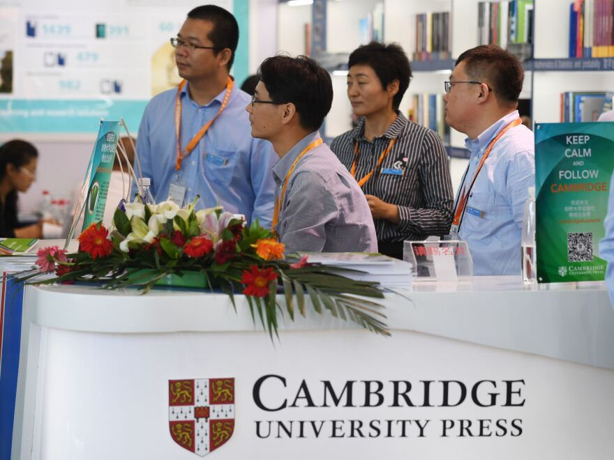 Staff wait at the Cambridge University Press stand at the Beijing International Book Fair in August. An international outcry ensued when the publisher agreed to block certain articles from one of its journals after pressure from Beijing. The press later reversed its decision.