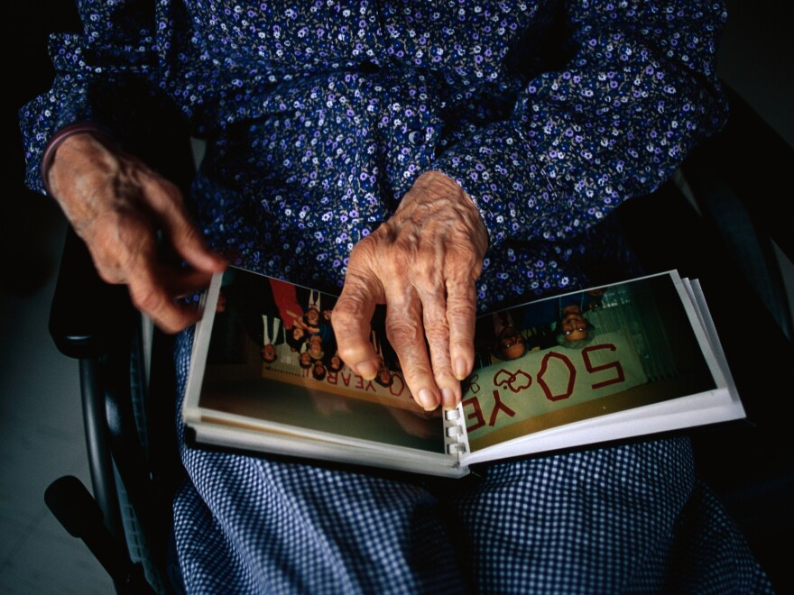 Researchers find that dementia patients who engage in activities such as gathering photographs and talking about family see improvements in their quality of life and are less agitated.