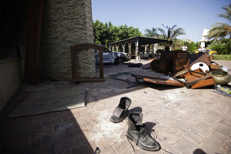 Broken furniture outside the U.S. consulate building in Benghazi on Thursday, following an attack on the building late on September 11.