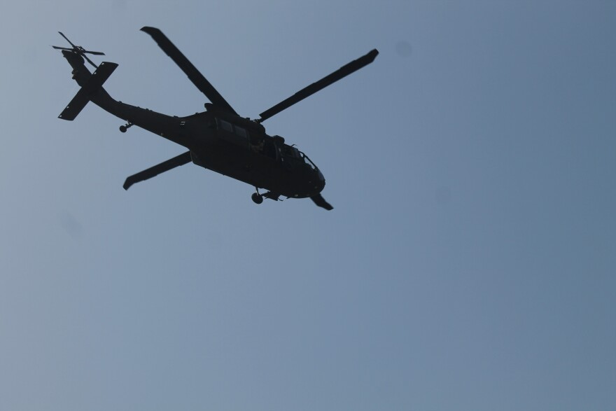 A helicopter flying near the Rio Grande.