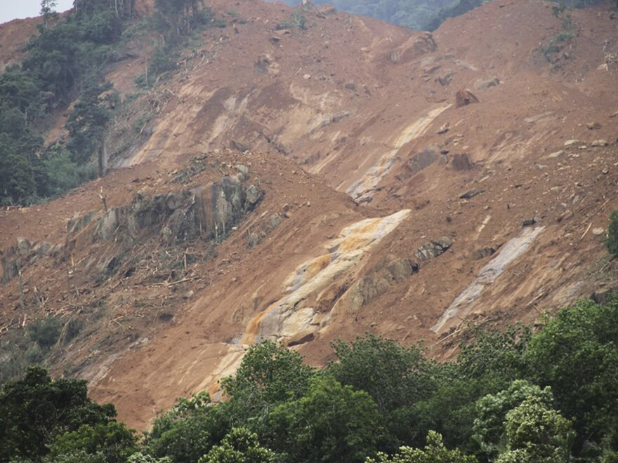 This photograph provided by the Sri Lanka Red Cross Society shows the aftermath of a landslide at Aranayake in Kegalle District. The Red Cross said more than 200 families are missing.