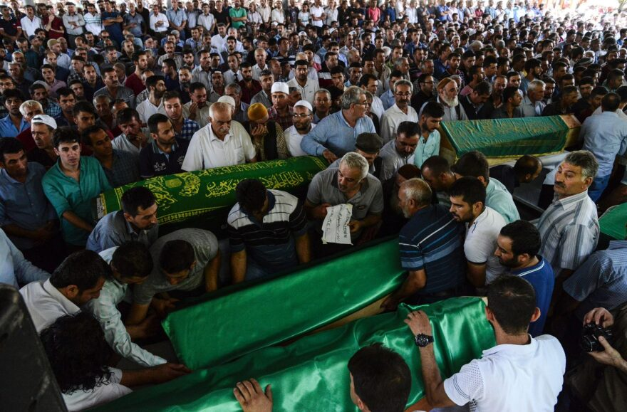 People gather for the funeral of victims of last night's attack on a wedding party that left 50 dead in Gaziantep in southeastern Turkey near the Syrian border on Aug. 21, 2016. (Ilyas Akengin/AFP/Getty Images)