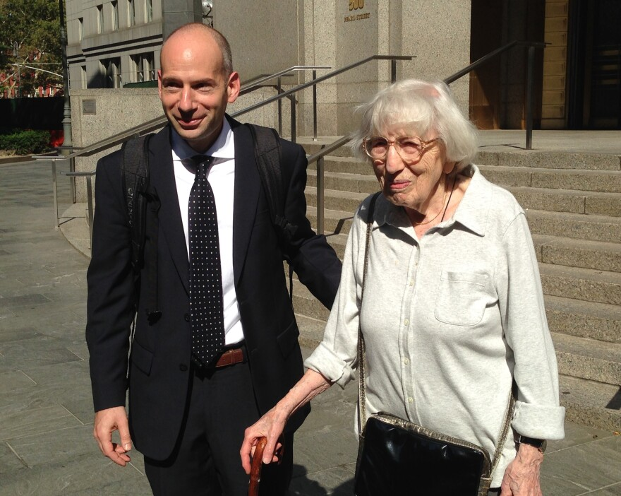 Miriam Moskowitz leaves a federal court in New York with her lawyer Guy Eddon, in August. Moskowitz, 98, was convicted of conspiracy during the McCarthy era and now wants to clear her name as well as warn others of what happens when fear fuels persecution.