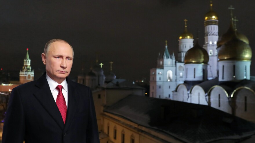 Russian President Vladimir Putin during the recording of his 2017 New Year's message. Putin's spokesman said the Russian government does not gather compromising material, or <em>kompromat,</em> on political rivals, despite a well-documented history of such behavior.