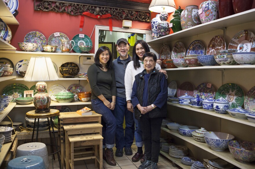 Three generations — Mei's sister Lina (left), her father Gary, Mei and her grandmother Nancy— help run Wing On Wo.