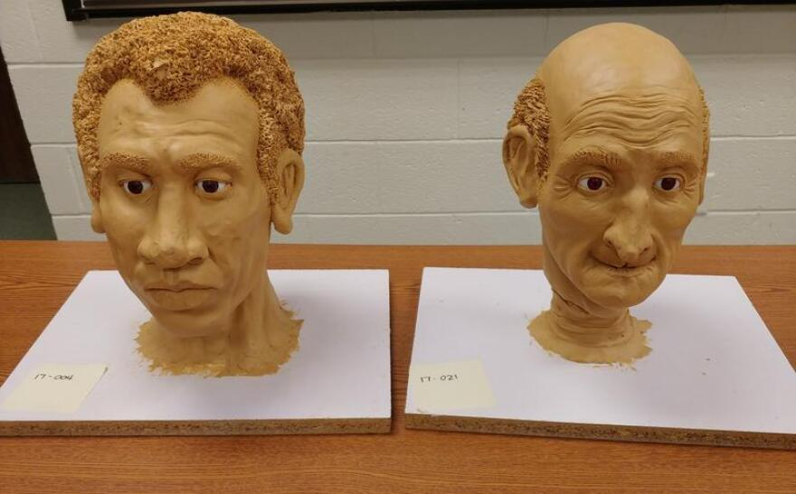 """A pair of reconstructions of unidentified murder victims from this year's USF """"Art of Forensics"""" event."""