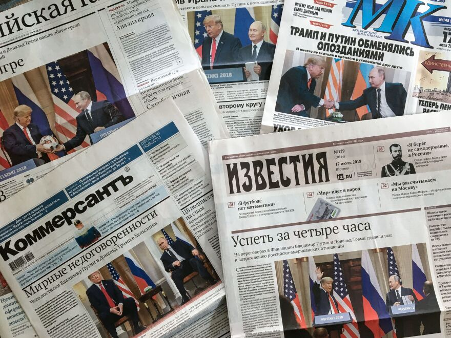 The front pages of Russia's July 17 newspapers feature pictures of the summit between President Trump and Russian President Vladimir Putin in Helsinki.
