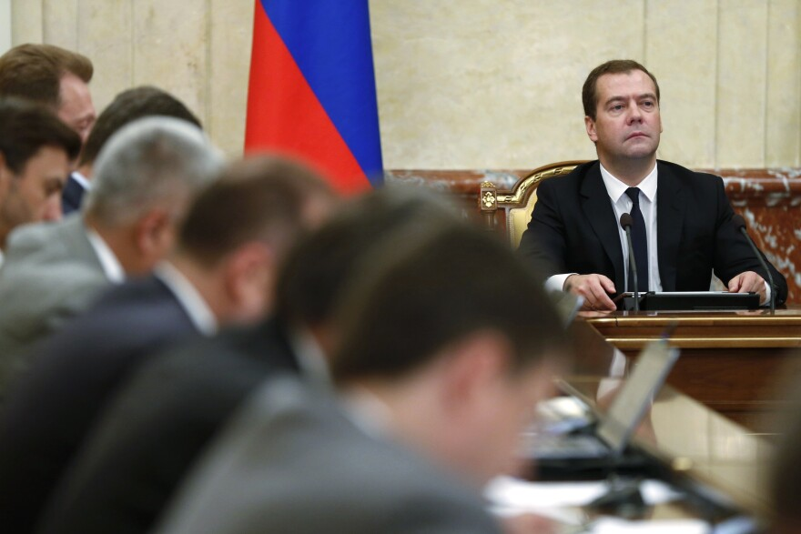 Russian Premier Dmitry Medvedev, right, heads the Cabinet meeting in Moscow on Thursday.