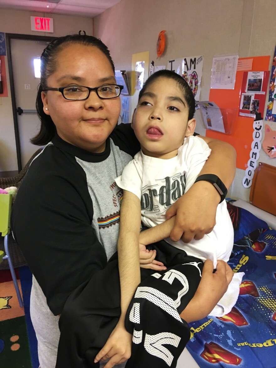 Felencia Woodie holds her son Dameon David, 8. He is one of seven medically fragile children who attend Saint Michael's Association for Special Education.