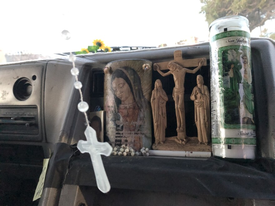 Armando Ibarra, a hotel restaurant worker in San Francisco, lives out of his van to save money — and to avoid an hours-long commute from San Jose, Calif. A holy candle rests on his dashboard; a rosary hangs from the rearview mirror.