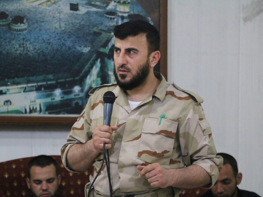Zahran Alloush, head of the Army of Islam Syrian rebel group, speaks during the wedding of a fighter in the group on July 21, 2015, in the rebel-held town of Douma, Syria.