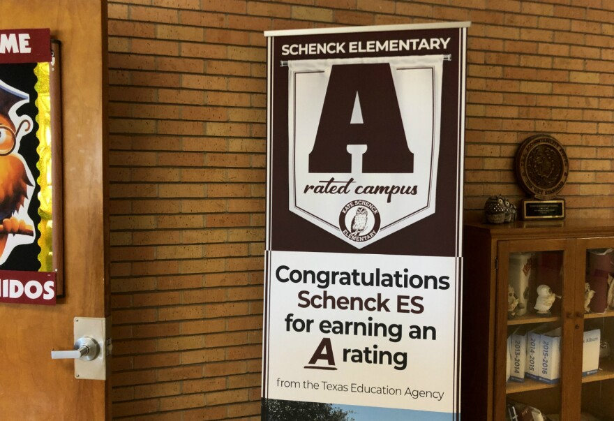 A banner celebrating Schenck Elementary's A rating greets guests at the door to the school August 15, 2019.