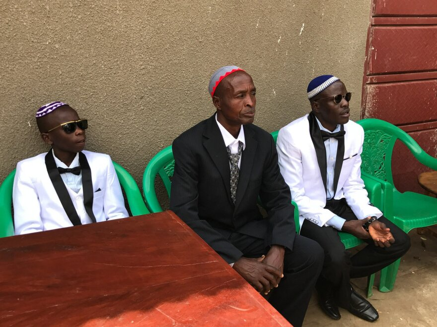 Shadrach Mugoya Levi (right) at his 2017 wedding in Uganda. With him are his son Oren Levi (from left) and Moshe Isiko.