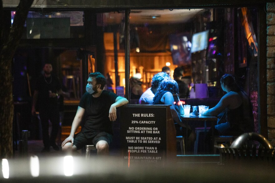 """As bars and restaurants reopen in Texas, Dr. Peter Hotez of Baylor College of Medicine says Texans might be getting a """"false sense of complaceny."""" A rise in cases during July or August could put the health care system and the economy at further risk."""