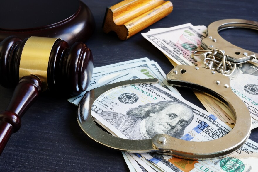 pic of gavel, handcuffs, cash