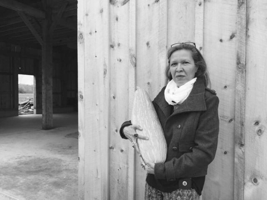 Punkin Shananaquet, a member of the Gun Lake tribe, holds a Gete Kosman squash at the Gteganes Farm in west Michigan. This squash, which until recently was thought to be extinct, is one of dozens of traditional crops being cultivated as part of a revival of foods native to the Great Lakes region.