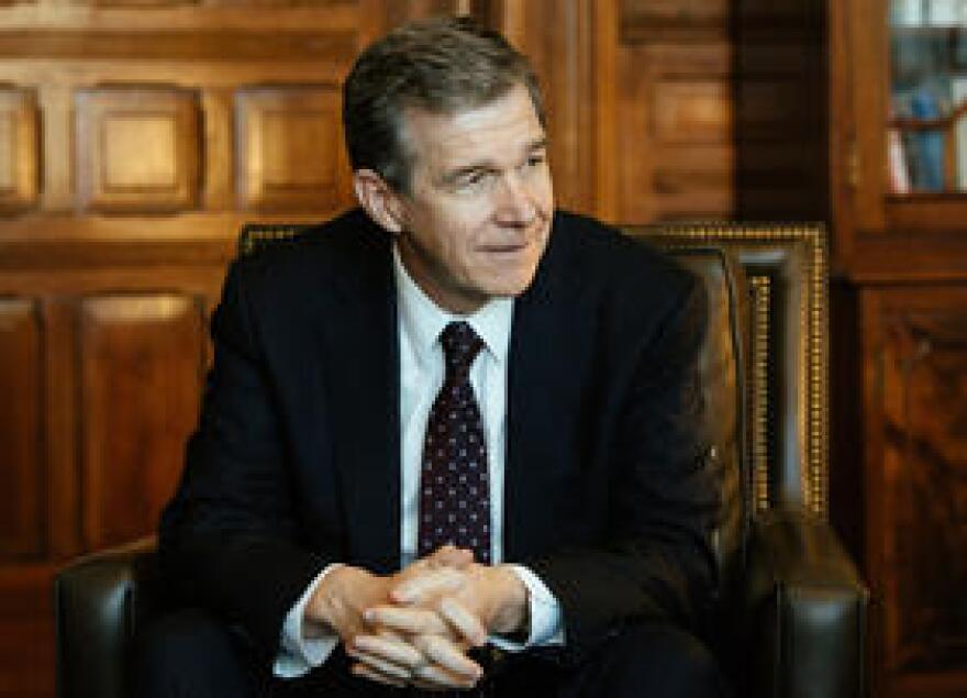 File photo of North Carolina Gov. Roy Cooper. Republicans have started overriding Cooper's veto of state budget adjustments for next year.