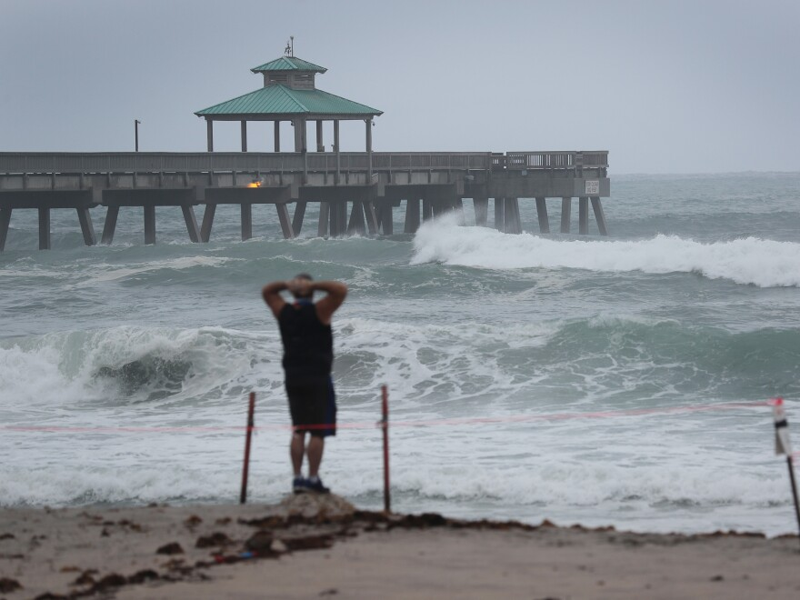 Waves kicked up by Tropical Storm Isaias crash along Deerfield Beach, Fla., on Sunday. Isaias is expected to make landfall as a hurricane in the Carolinas on Monday evening.