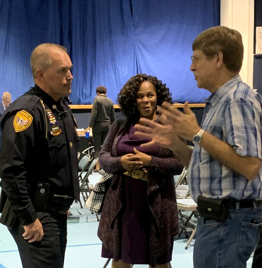 Newly named police chief Lawrence Revell talks with community members during a meet and greet.