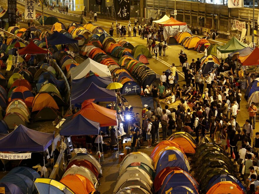 Pro-democracy protesters gather during a rally of the ongoing Occupy Central movement in the Admiralty District of Hong Kong on Monday. The territory's leader has accused foreign elements of helping stoke unrest.