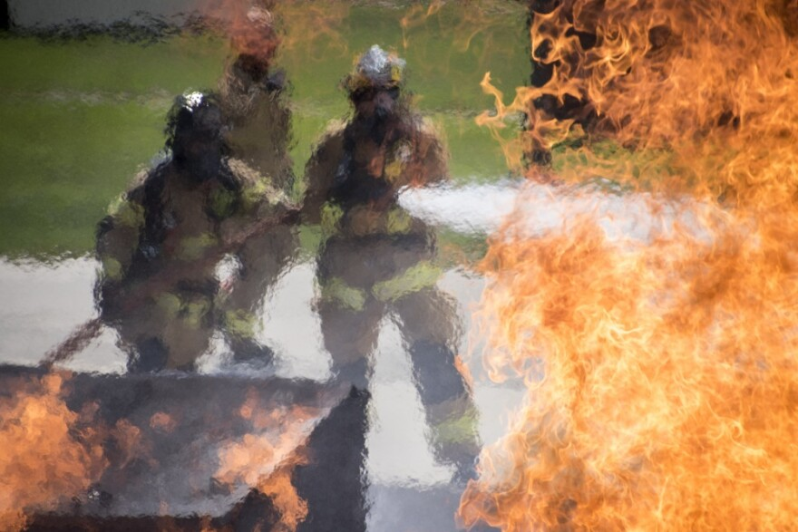 guardsmen extingishing a fire