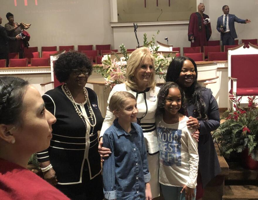 State Sen. Linda Chesterfield, Dr. Jill Biden and State Rep. Jamie Scott pose with children at First Baptist Church in North Little Rock.