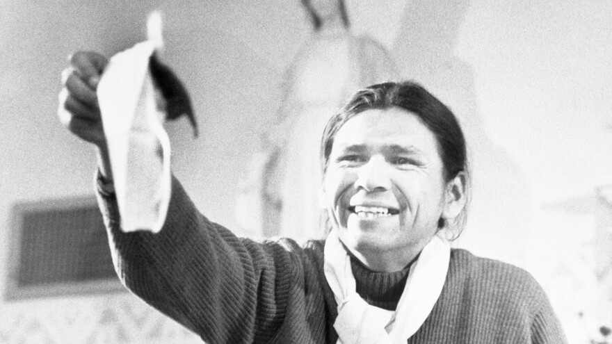 Dennis Banks, a leader of the American Indian Movement, burns a government proposal that would have let the AIM occupiers leave Wounded Knee in 1973. The Native American protesters then put the ashes into an envelope and sent it back to the government.