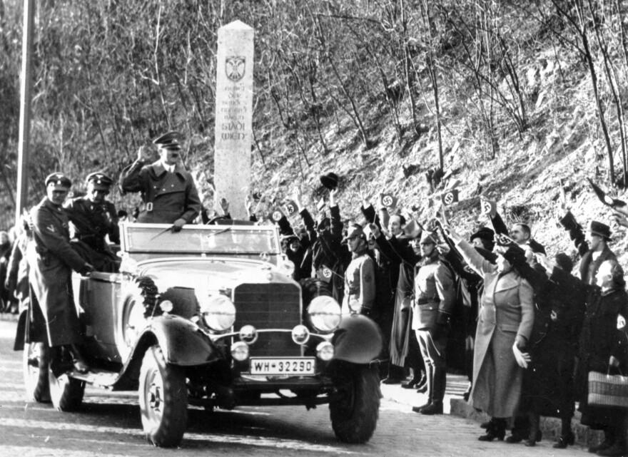 Adolf Hitler enters the city limits of Vienna, Austria, on Mar. 14, 1938.