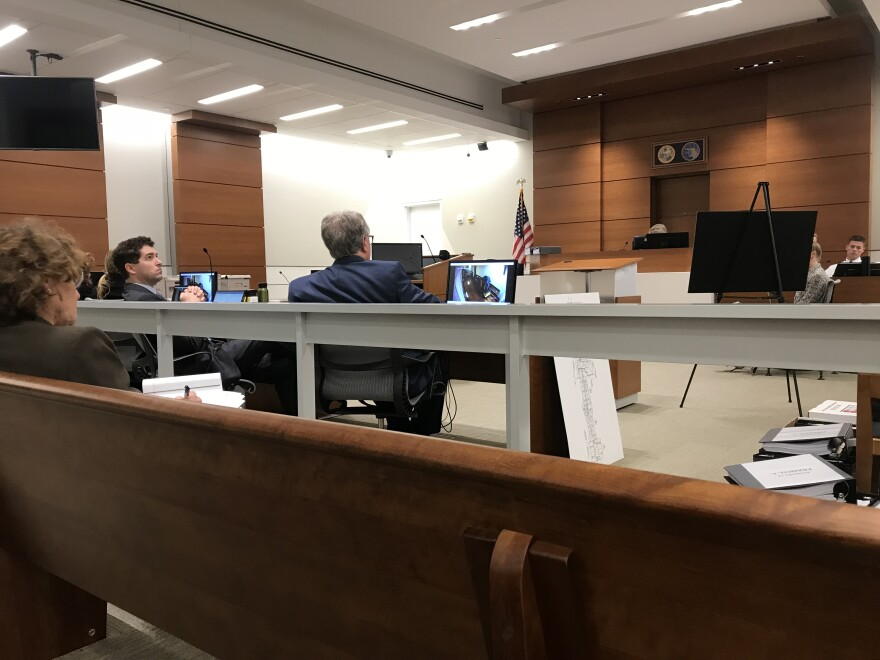 Inside of the courtroom, state administrative law Judge Mary Li Creasy presides, while attorneys on both sides sit next to each other.