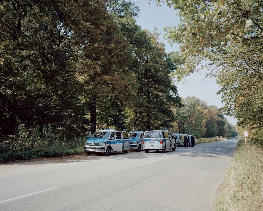 Police cars line up outside Hambach Forest. The eviction of activists began on Sept. 13, 2018. For five days, special forces and police destroyed the treehouses and arrested activists — until a journalist fell from a tree and died, halting the process.