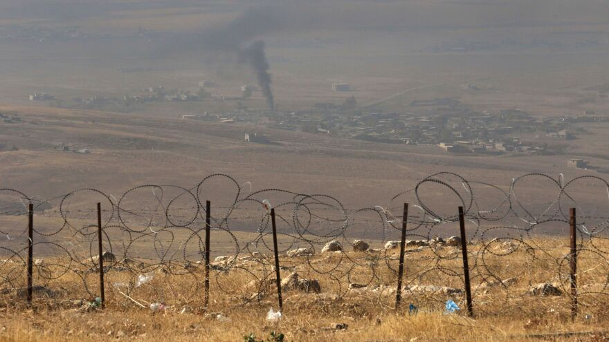 A picture taken from the top of Mount Zardak, about 25 kilometers east of Mosul, shows smoke billowing in the Iraqi city of Nineveh during an operation against the Islamic State on Monday — part of a broad operation to retake the city from the Islamic State group.