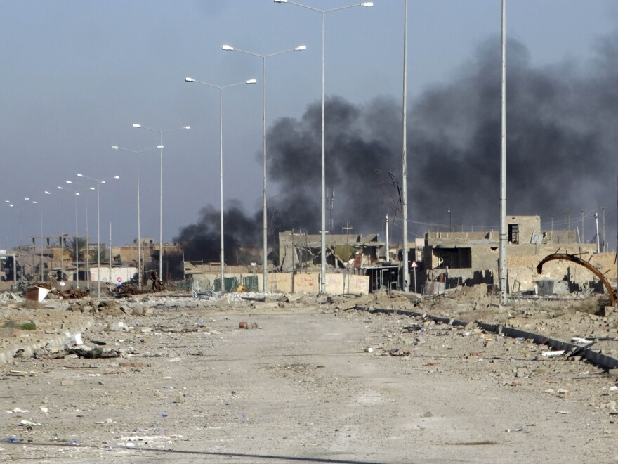 Smoke rises from ISIS positions following a U.S.-led coalition airstrike in the Huz neighborhood in downtown Ramadi, Iraq, on Saturday.
