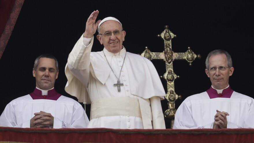 Pope Francis delivered his Christmas day blessing from the main balcony of St. Peter's Basilica at the Vatican Sunday, before a crowd of some 40,000 people.