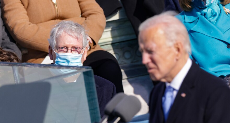Senate Republican leader Mitch McConnell looks on as President Biden delivers his inaugural address outside the U.S. Capitol on Wednesday.