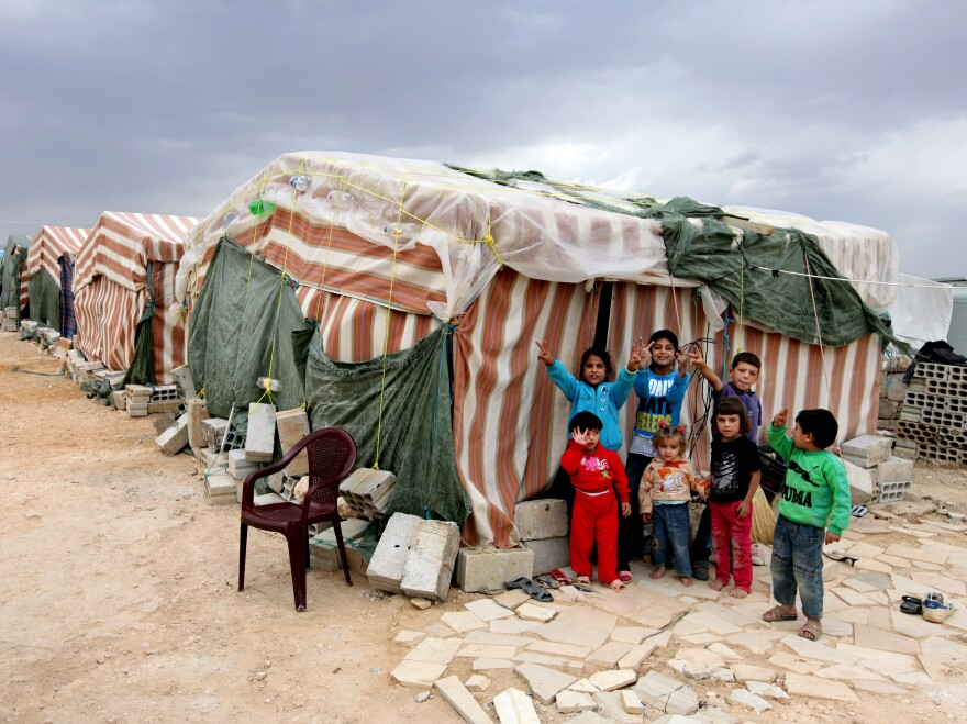 Syrian children flash victory signs Oct. 2 as they stand in front of their tents at a refugee camp in Arsal, a Sunni Muslim town in eastern Lebanon near the Syrian border. The town has become a safe haven for war-weary Syrian rebels.