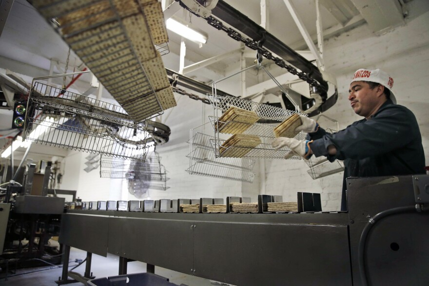 Edwin Caballeros loads fresh-baked matzos into a packaging machine at the Streit's factory in New York on March 4.