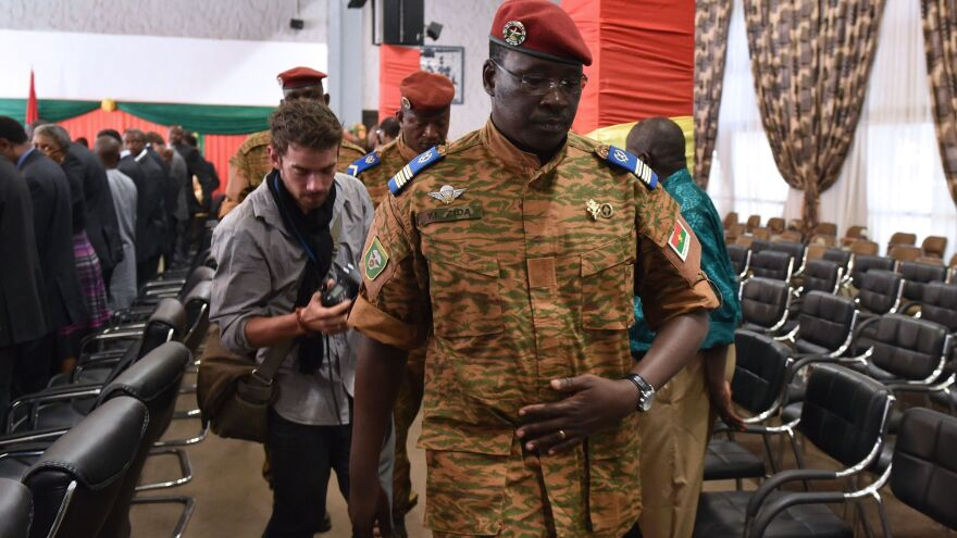 Lt. Col. Isaac Yacouba Zida, named by Burkina Faso's army as interim leader following the ousting of President Blaise Compaore, leaves after a meeting with diplomats on Sunday in the capital Ouagadougou.